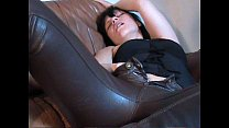 Horny girl in brown leather pants masturbating on leather couch