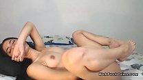 Naked Latina amateur masturbates on cam