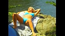 Playful blonde peacherino Nancy Sweet taking sun baths near the forrest lake closed with an offer to hook up with stranger