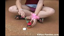 Kitty blowing bubbles in her miniskirt