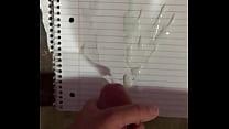Jerking big thick cock shoots massive cumshot on paper
