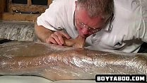 Saran wrapped hunk getting sucked and tugged