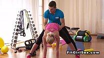 Flexible slim blonde fucking in gym