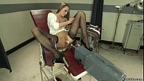 Babe in gyno chair fucks machine