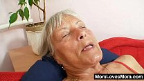 Ugly grandma Cecilie toys her  hairy pussy preview image