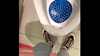 peeing in a urinal in a public toilet
