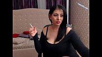 Brunette milf smoking cig and showing huge bobs on cams22.com
