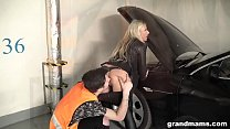 Old and rich leather dressed slut fucks the car repair guy صورة