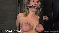 Tied up cutie waits with fear for her next sexy castigation