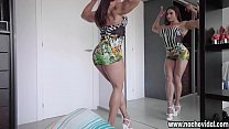 Karyn Bayres is a super-stacked Argentinean powerhouse of muscular womanhood.This busty and athletic MILF flexes her sculpted body in front of a mirror and gets excited. pornhub video