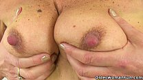 British gilf Dolly pushes a dildo up her fanny thumbnail
