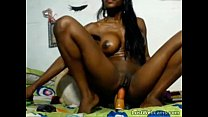 Busty ebony babe rides dildo on webcam preview image