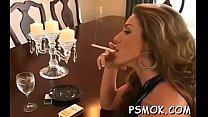 Charming babe sucks a dick like a pro while smokin' a cig