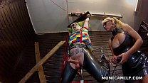 Kinky Norwegian MonicaMilf is pegging the dirty clown upside down image