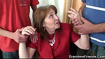 Naughty granny takes two rods Image