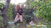 Redheaded Babe Pisses Long And Hard In Trees