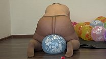 A fat girl in pantyhose sits down on balloons and pisses