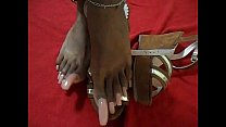 Black Latina with pink long  toenails