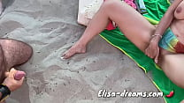 Naughty at beach in front of a lot of voyeurs