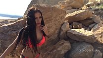 Alone lush Russian babe toys her cunt on the rock on the sea shore