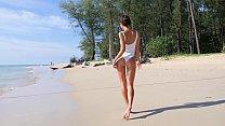 Sexy teen on a beach teasing with her ass in one piece bikini