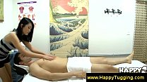 Asian masseuse finds a tensed muscle Image