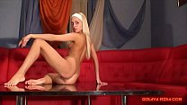 Beautiful Russian blonde Julia posing in front of porn casting