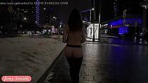 Jeny Smith naked in snow fall walking through the city صورة