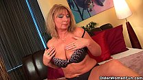 Grandma Irena with her big tits finger fucks her oiled pussy