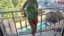 Flash and nude on the balcony