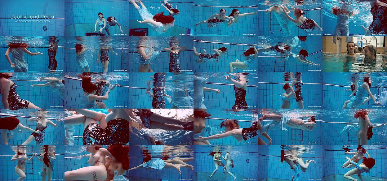 Die vollbusigen Teenager Dashka und Vesta streicheln sich unter Wasser