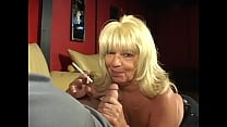 Tobacco smoking mature blonde Ginni Lewis with big tits enjoys cigarette and dick
