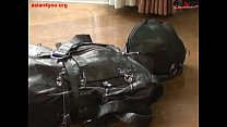 Ballgagged asian girl tied into a leather sleepsack teased and vibed thumbnail