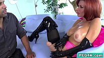 Sexy MILF fucks her man with a big strap-on.