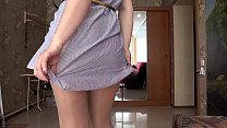 The girl measures pantyhose and stockings and then pushes her panties into her p
