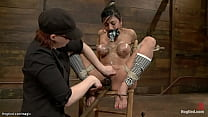 Busty sub suspended for legs on hogtie