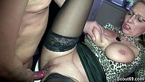 Horny MILF with big tits and suspenders fucks young boy