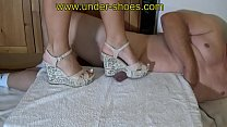 Milfs in wedges stomping mens balls