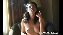 Attractive youthful girl teases and smokes in hot underwear