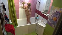 Naked chick with big tits in the shower