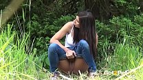Squatting To Pee - Brunette Rebecca pulls down her denims to piss