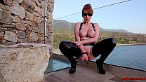 Mature British redhead masturbating on the balcony