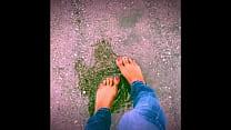 Jasmine plays in the rain barefoot!
