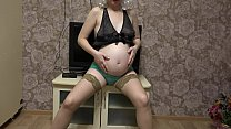 Pregnant milf with a juicy ass in sexy outfit is excited and masturbating with a dildo. thumbnail