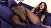 Redhead wearing black pantyhose shows off firm ...