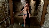 Gagged redhead on hogtie is suspended