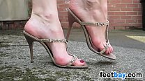 Walking Outdoors In Sexy High Heels