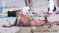 teens lesbians public kissing and massage on the beach preview image