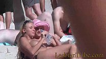 teens lesbians public kissing and massage on the beach thumbnail