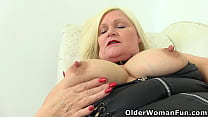 Busty gilf Lacey Starr puts her massager to work